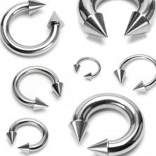 Piercing srebrnego koloru ze stali chirurgicznej - podkowa zakończona stożkami