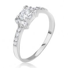 Srebrny pierścionek - kokardka wyłożona błyszczącymi, przezroczystymi cyrkoniami