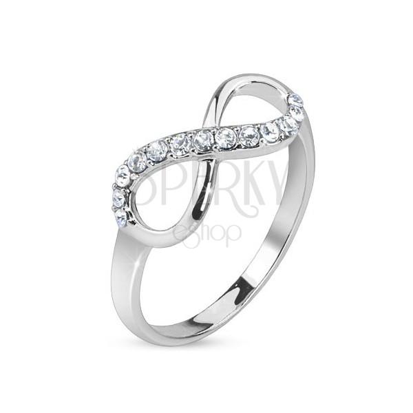 Srebrny pierścionek, symbol nieskończoności ozdobiony przezroczystymi kamyczkami