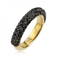 Stalowy pierścionek w złotym kolorze ozdobiony czarnymi cyrkoniami