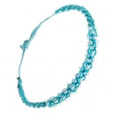 Bransoletka z zaplatanych lazurowych sznurków z przezroczystymi koralikami, spirala