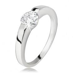Srebrny pierścionek, rozszerzające się ramiona, okrągła przezroczysta cyrkonia, srebro 925