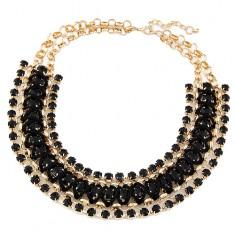 Masywny naszyjnik - okrągłe ogniwa złotego koloru, czarne kamyczki i sznurek