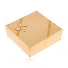 Pudełeczko prezentowe w złotym kolorze na biżuterię, wygląd tkaniny, kokardka