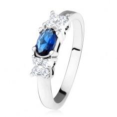 Błyszczący pierścionek - srebro 925, ciemnoniebieska owalna cyrkonia, koniczynka, przeźroczyste kamyczki