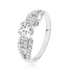 Srebrny pierścionek 925, przezroczyste kamyczki, rozdwojone przewiązane ramiona, boczne zdobienie