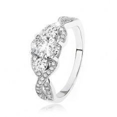 Błyszczący srebrny pierścionek 925, skrzyżowane pofalowane ramiona, owalna cyrkonia