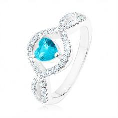 Srebrny pierścionek 925, jasnoniebieskie cyrkoniowe serce, faliste przejrzyste ramiona