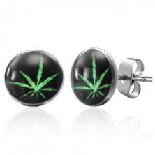 Stalowe kolczyki wkręty, zielona marihuana na czarnym tle