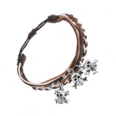 Pleciona bransoletka, brązowe, czarne i białe sznurki, stalowe czaszki z kośćmi