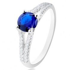 Pierścionek ze srebra 925, ciemnoniebieska okrągła cyrkonia, bezbarwne rozdwojone ramiona
