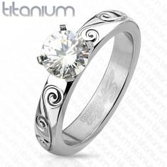 Tytanowy pierścionek srebrnego koloru, okrągła przezroczysta cyrkonia, ozdobione ramiona