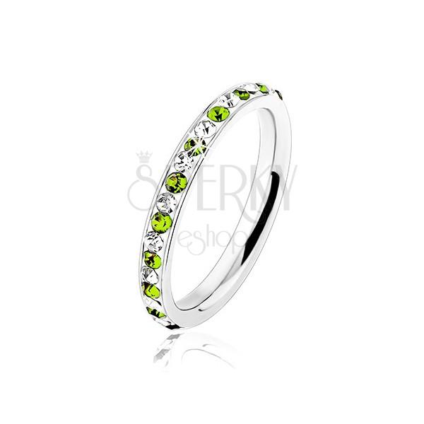 Stalowy pierścionek srebrnego koloru, bezbarwne i jasnozielone cyrkonie