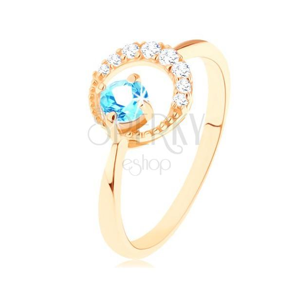Złoty pierścionek 585 - sierp księżyca ozdobiony przejrzystymi cyrkoniami, niebieski topaz