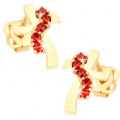 Kolczyki z żółtego 14K złota - krzyż z falistymi ramionami, czerwone cyrkonie