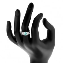 Lśniący pierścionek ze stali, przezroczyste cyrkoniowe pasy, owalna kolorowa cyrkonia