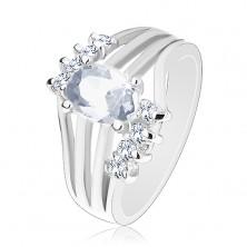Lśniący pierścionek srebrnego koloru, kolorowa owalna cyrkonia, lśniące pasy, przezroczyste cyrkonie