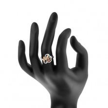 Błyszczący pierścionek srebrnego koloru, faliste pasy, pomarańczowe cyrkonie