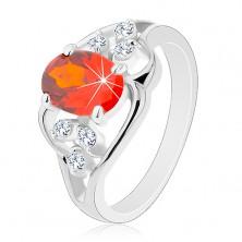 Pierścionek w srebrnym odcieniu, pomarańczowa owalna cyrkonia, faliste linie