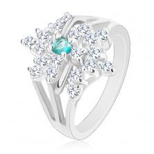 Pierścionek w srebrnym odcieniu, rozgałęzione ramiona, przezroczysty kwiat, jasnoniebieska cyrkonia
