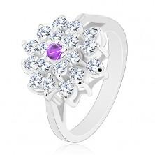 Pierścionek srebrnego koloru, duży przezroczysty kwiat z fioletową cyrkonią pośrodku