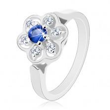 Pierścionek w srebrnym odcieniu, przezroczysty kwiatek z ciemnoniebieską cyrkonią