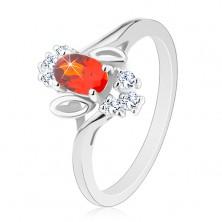 Pierścionek srebrnego koloru, ciemnopomarańczowy wyszlifowany owal, przezroczyste cyrkonie, listki