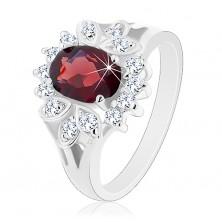Lśniący pierścionek z rozdzielonymi ramionami, duża ciemnoczerwona cyrkonia, przezroczysta oprawa