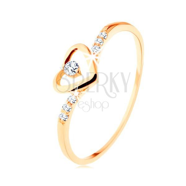 Złoty pierścionek 585, kontur serca z przezroczystą cyrkonią, ozdobione ramiona