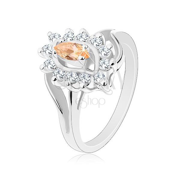 Błyszczący pierścionek w srebrnym odcieniu, pomarańczowe ziarenko, przezroczyste cyrkonie