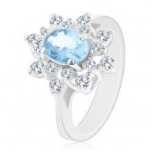Pierścionek srebrnego koloru, niebieska owalna cyrkonia, przezroczyste cyrkoniowe płatki