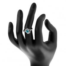 Lśniący pierścionek srebrnego koloru, niebieska okrągła cyrkonia, przezroczyste łuki
