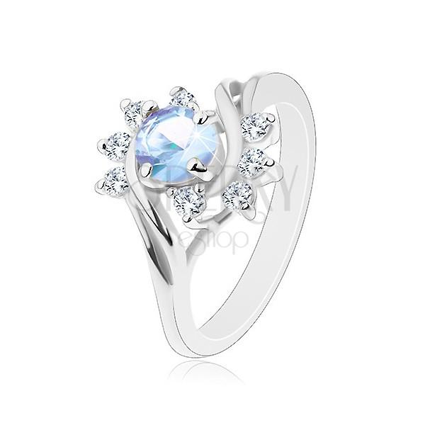 Pierścionek w srebrnym odcieniu, okrągła jasnoniebieska cyrkonia, błyszczące przezroczyste łuki