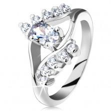 Pierścionek srebrnego koloru, rozdwojone ramiona, owalna cyrkonia, bezbarwne cyrkoniowe pasy