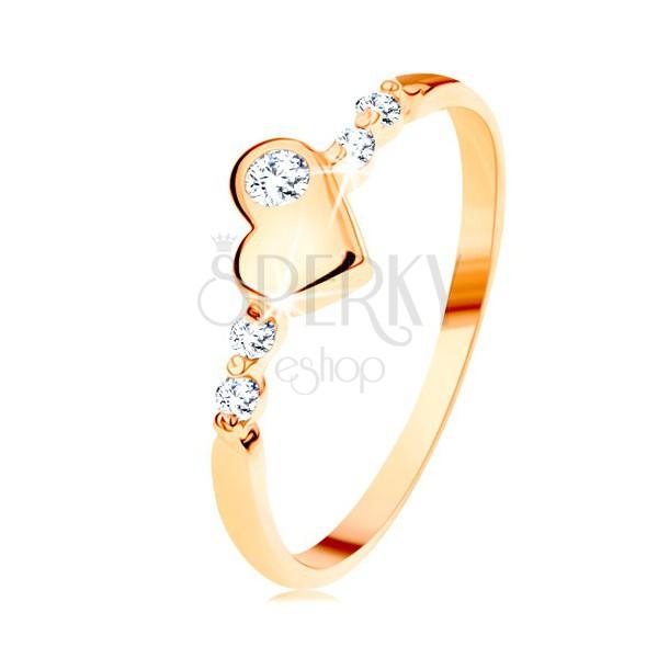 Złoty pierścionek 585 - wypukłe nieregularne serduszko, błyszczące przezroczyste cyrkonie
