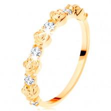 Pierścionek z żółtego 14K złota - różyczki na przemian z okrągłymi przezroczystymi cyrkoniami
