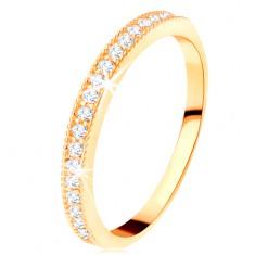 Złoty pierścionek 585 - przezroczysty cyrkoniowy pas z podwyższoną karbowaną oprawą