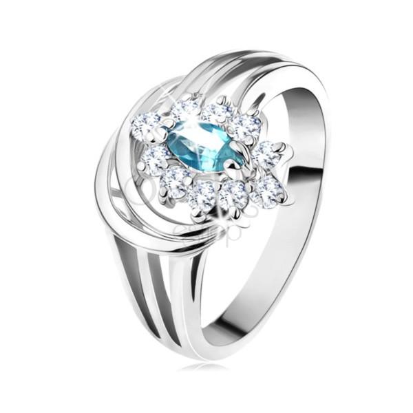 Lśniący pierścionek z rozgałęzionymi ramionami, jasnoniebieskie cyrkoniowe ziarenko, łuki