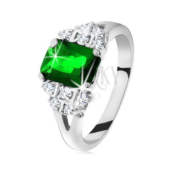 Błyszczący pierścionek srebrnego koloru, szmaragdowo zielona cyrkonia, rozdzielone ramiona
