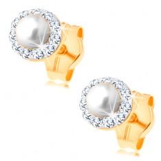 Kolczyki z żółtego 14K złota - okrągła biała perełka w przezroczystej błyszczącej oprawie
