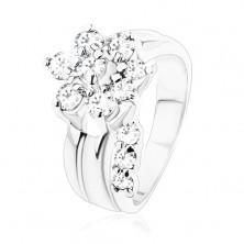 Pierścionek srebrnego koloru, błyszczący kwiatek z przezroczystych cyrkonii, rozdzielone ramiona