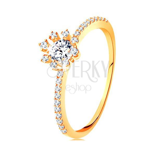 Pierścionek z żółtego 14K złota - przezroczysty błyszczący kwiatek, cyrkoniowe ramiona