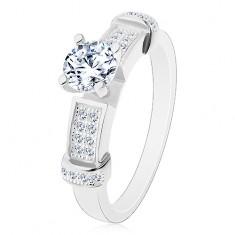 Srebrny pierścionek 925, okrągła cyrkonia bezbarwnego koloru, dekoracyjne ramiona