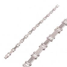 Stalowa bransoletka srebrnego koloru z bezbarwnymi cyrkoniami a greckim kluczem