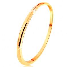 Cienka obrączka z żółtego 14K złota, gładka i lekko wypukła powierzchnia