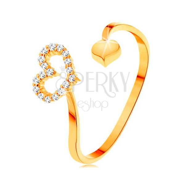 Złoty pierścionek 585 - faliste ramiona zakończone zarysem serca i pełnym serduszkiem