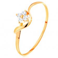 Pierścionek z żółtego 14K złota - przezroczysty cyrkoniowy kwiatek, faliste ramię