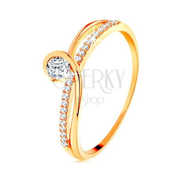 Złoty pierścionek 585 z rozdzielonymi zaplecionymi ramionami, przezroczysta cyrkonia