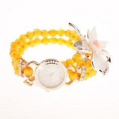 Zegarek z przejrzystych żółtych koralików, cyferblat z cyrkoniami, duży kwiat