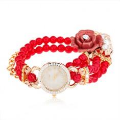 Zegarek analogowy, czerwona bransoletka z koralików, cyferblat z cyrkoniami, róża